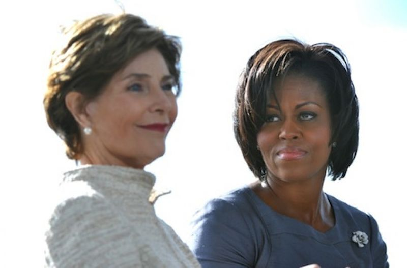 First Lady Michelle Obama (R) sits next to former First Lady Laura Bush during a service of remembrance for Flight 93 and the terrorist attacks of 9/11, in Shanksville, Pennsylvania on September 11, 2010. United Flight 93 crashed into a field in rural Pennsylvania after the crew and passengers fought back against terrorist attempts to hijack the airplaine on September 11, 2001.