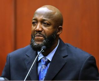 Police testify Trayvon's father said taped screams were not his son's